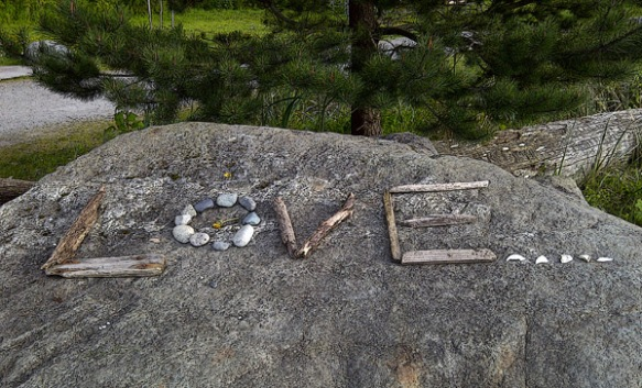 Love written on a rock in twig-stone-shell typography